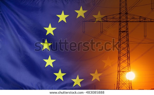 Concept Energy Distribution, Flag of Europe with high voltage power pole during sunset