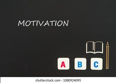 concept english school, text motivation, abc letters, chipboard miniature book, pen on blackboard