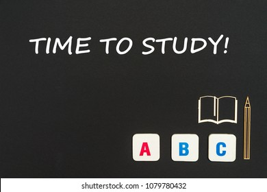 concept english school, text time to study, abc letters, chipboard miniature book, pen on blackboard