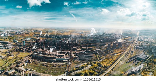 Concept of environmental pollution, drone view of smokestack pipe steel plant, aerial industrial panoramic landscape with blue sky and autumn vegetation, air emissions from manufacturing sector,Russia
