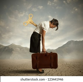 Concept of an exhausted businesswoman in a desert