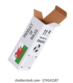 Concept of export, opened paper box - Product of Wales