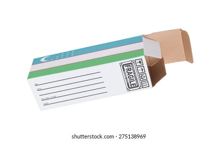 Concept of export, opened paper box - Product of Uzbekistan