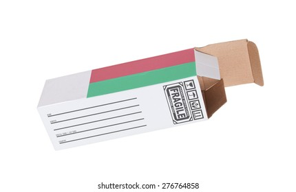 Concept of export, opened paper box - Product of Madagascar