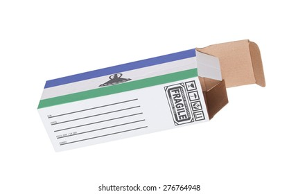 Concept of export, opened paper box - Product of Lesotho