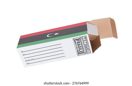 Concept of export, opened paper box - Product of Libya
