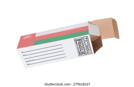 Concept of export, opened paper box - Product of Oman