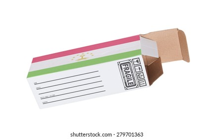 Concept of export, opened paper box - Product of Tajikistan