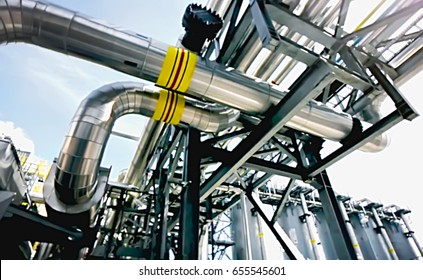 Concept. The extraction of natural resources, gas and oil. Pumping and storage. Abstract, blurry, bokeh background, image for the background.