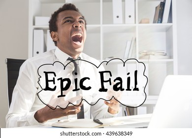 Concept of failure with screaming furious black businessman at office desk with laptop, notepad and 'epic fail' text