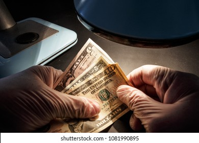 The concept is fake dollars or money laundering. The detective holds a bribe for bribery in business.