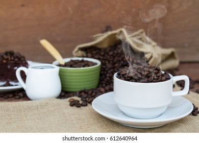 Concept Fall in love with coffee crazy any coffee whether it is a cake, milk or any coffee on wood table and wooden background with copy space. selective focus.