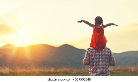 concept of family. father and child daughter outdoors in summer