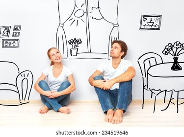 Concept family: Happy couple in the new apartment dream and plan interior