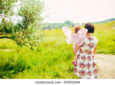 concept of family. mother and child daughter outdoors in summer