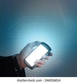 Concept family protection,  businessman with cell phone displaying hologram