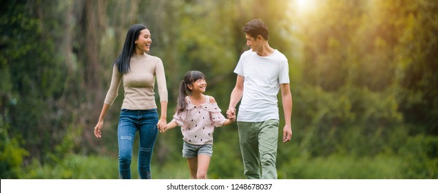 Concept Family relaxation.Asian family playing in the garden