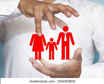 The concept of family safety, health, life. Dad, mom and baby. Insurance is related to the image of a family under the protection of human hands.