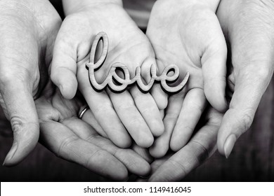 concept of family values - hands holding word love