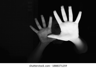 the concept of family violence. baby's hands on a black background