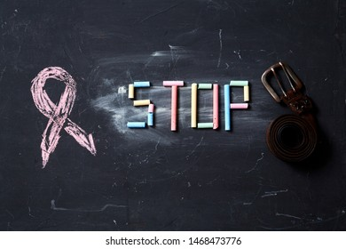 Concept for fear, domestic violence and family or child abuse. Stop sign and belt