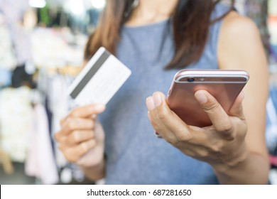 concept female to shopping Convenient instant. Customers can use the phone to shopping online Order purchase Sell and Payment with Credit Cards Do not have to travel having to shop store.