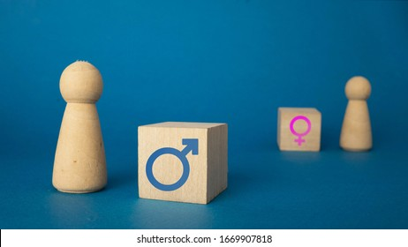 the concept of figures means the predominance of the male over the female. on a blue background