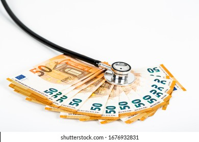 Concept of financial impact of covid-19 on European money area. Pack of fifty euros bills on white background with stethoscope on notes