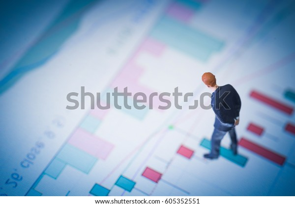 Concept of financial stock market. Businessman thinking with stock market number.