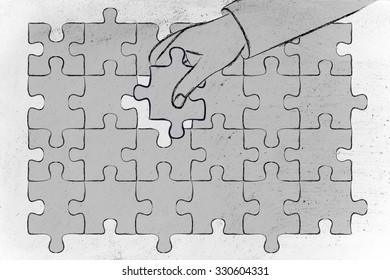 concept of finding solutions, hand about to add the missing piece to a jigsaw puzzle