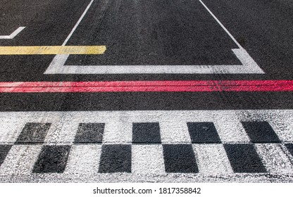 Concept of finish, top, winner, goal, motorsport checked finish line close up on rough asphalt track