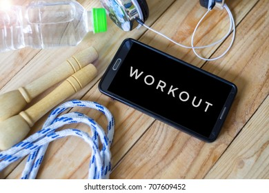 Concept Fitness, healthy and active lifestyles concept, selective focus and soft focus for background with word WORKOUT
