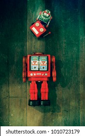 concept fixing your head with rteo robot toys on old wooden floor