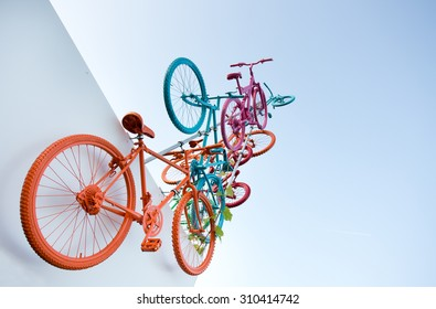 Concept of flying colorful bicycles in the air