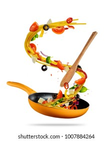 Concept of flying food preparation with traditional italian pasta and vegetable in pan. Isolated on white background. Very high resolution image