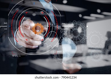 Concept of focus on target with digital diagram,graph interfaces,virtual UI screen,connections netwoork.Businessman showing gear or cog for sucess business.