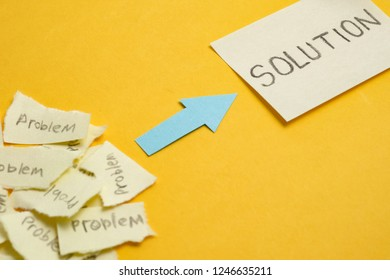 """The concept of the found solution from a set of unsolved problems. Ripped stickers with the word """"problem"""" with a sticker that says """"solution"""" on a yellow background."""