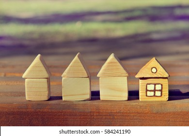 concept of four wooden houses one of whom ready for living / different from other
