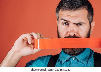 Concept freedom of speech and press. man wrapping mouth by adhesive tape. International Human Right day. censorship. Brutal bearded male. Mind control and propaganda. express opinion and truth.