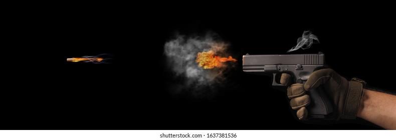 concept of freezing shot of a gun on a dark backgroundFreezing shot of a gun on a dark background. Concept gun club, gun-shop, shooting range.