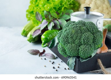 Concept of fresh broccoli green lettuce, cabbage, cucumber, dill, lime on a light background. Selective focus.Healthy raw Organic  food.Top view. Copy space.
