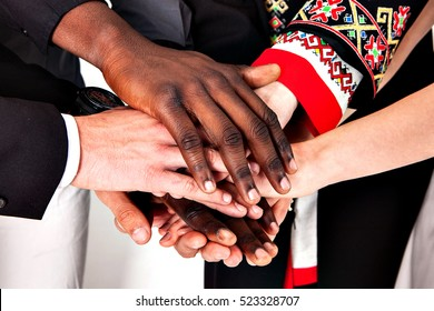 The concept of friendship, support, community, communication, teamwork. Different people shaking hands.