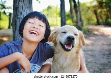 Concept : funny lifestyle with my family pets , Little Asian Girl with her dog in happy time.