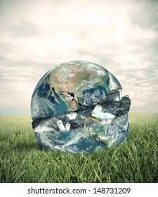 Concept of garbage with the world in a green field. Word provided by NASA.