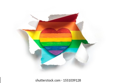 concept of gay pride, LGBT. Hand making heart sign with LGBT gay pride, heart with a rainbow flag