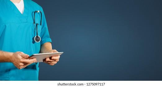 Concept of global medicine and healthcare. Doctor holds digital tablet. Diagnostics and modern technology on blue background