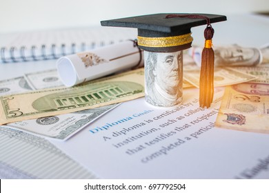Concept of graduation black cap on roll up Dollars bill, with diploma or certificate on letters, foreign money US dollars, Singapore. Education of competition on abroad in famous institution.