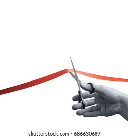 The concept of the grand opening of something. Scissors in female hands cuts the red satin ribbon. Black and white.
