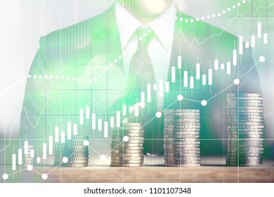 Concept of growth in a growing business. Manager in the background and graphs with money stacks in a double exposure.