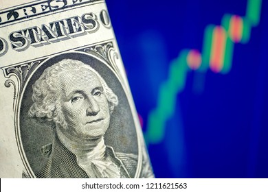 The concept of growth of the US dollar exchange rate. One dollar on a blue chart background.